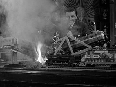 Ka-boom! Gomez Addams blowing up his train layout, photo fark.com