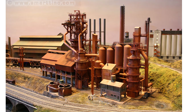 Here is a broadside view of that steel mill. The building in the back right is a Lime Kiln. Below is the interior of the Cast House, with molten pig iron flowing down to the loading chutes and then into the bottle cars.
