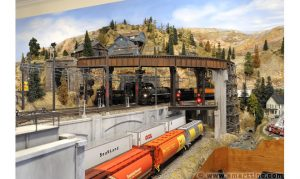 The rusty deck plate girder bridge is ideal for a curved track. There's no worry about swing-out from the train running across it. Below, there is more than adequate clearance for the tallest rolling stock.