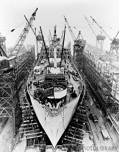Construction of a Liberty ship. Historical image showing a Liberty ship being built at Bethlehem Fairfield shipyard, Maryland, USA. Liberty ships were cargo ships built in the USA during World War II. They were cheap, quick to build (being ready for launch after only 24 days) and came to symbolise US wartime industrial output. 18 American shipyards built 2,751 Liberty ships between 1941-1945. Photographed in April 1943.