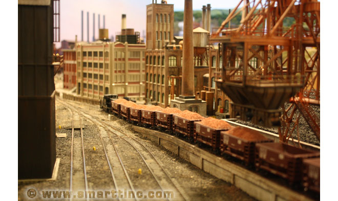 In this photo, iron ore is being hauled away from the yard on its way to the steel mill.