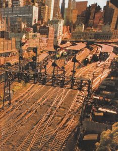 John pioneered many model railroad techniques that influenced others in the hobby. Cityscaping was one area. Here we see John's influence on Rod Stewart's Three Rivers model railroad, Photo Staticflickr.com