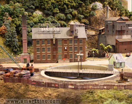I am sure there are a lot of locals in town who own a Zane-Seeger Banjo, I could just imagine what a Saturday night sounds like down at the old UMWA union hall. In the background is another hole in the ground for those black diamonds. This is the second largest mine on the layout, and the largest employer in town.