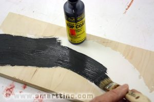 Woodland Scenics' Asphalt paint is the first color layer you will paint onto the road surface.