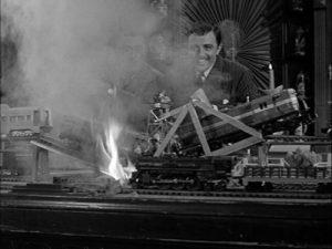 Ka-boom! Gomez Addams blowing up his train layout, photo fark.com