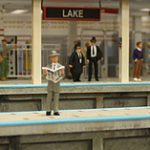 Waiting on the platform at Chicago's Lake Street subway station. I don't know about you, but those two guys in the black suits look awfully familiar!