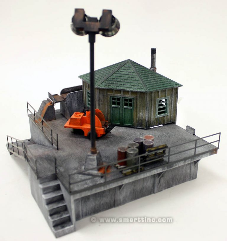 A dash of paint and some aftermarket railings and barrels brings life and realism to this classic Lionel Accessory