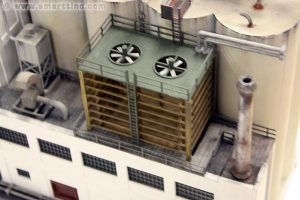 Here is the cooling tower from the Jack Frost kit (center), plus another blower vent and one of the roof top storage bins from the Walthers' Medusa Cement Plant.