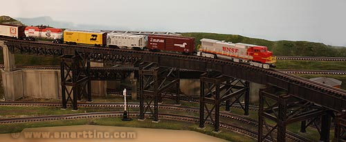 The legs on this multi-section deck plate girder bridge needed special consideration to clear the swing-out of locomotives and long cars traveling on the curved track below.