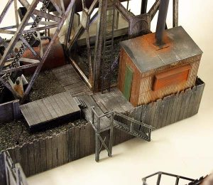 Details like the fuel tanks and shed cover the toys' electrical terminals