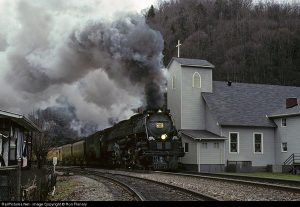 """UP's Challenger now lettered Clinchfield and numbered 676, hammers by the Union Baptist Church at Dante--a """"Clinchfield Country"""" icon"""