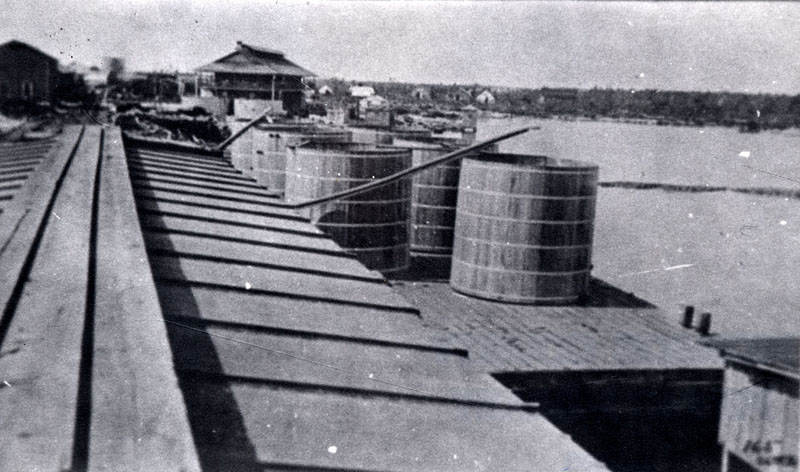 Florida East Coast Railway, Key West Extension. From Marathon Dock during construction days.  Water barge at right, accounting office at left.  Hotel left center. Photo from the Monroe County Library Collection.