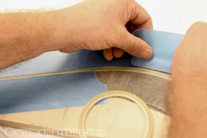 Mask the road surface for street lines. Scotch Blue tape works well for this because it has low tack adhesive.
