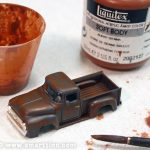 Burnt Sienna wash is the first layer of weathering, applied liberally over the whole surface. Don't worry about the windshield; we're using acrylics which can be wiped from the transparency later with alcohol. If in doubt of whether your wash will harm the surface below, be sure to test it first.