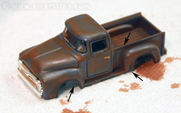 Now that we've dry-brushed a little Burnt Umber, another good rust color, in a few sharp edged places like the running boards and the edge of the bed.