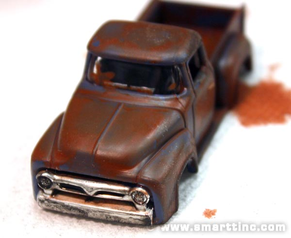 Dull down the shiny chrome with a black wash to get into the crevices and generally mute the shine.