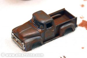A light dry-brush of acrylic silver gives a subtle hint of the metallic nature of the truck body.