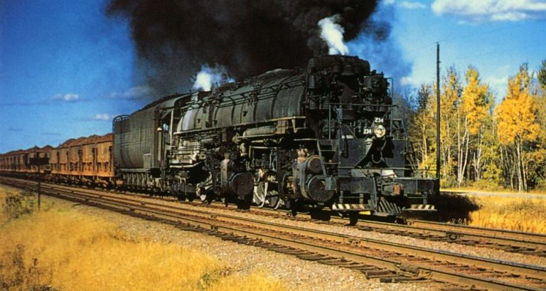 A DM&IR 2-8-8-4 Yellowstone with a long string of ore jennies (shorter open hopper cars) heading for the loading docks on Lake Superior, photo steamlocomotive.org.