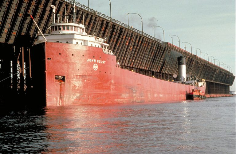 A Lake Superior ore dock with the ore boat John Hulst, note the ore jennies at the end of the dock, photo, Wikimedia.org.